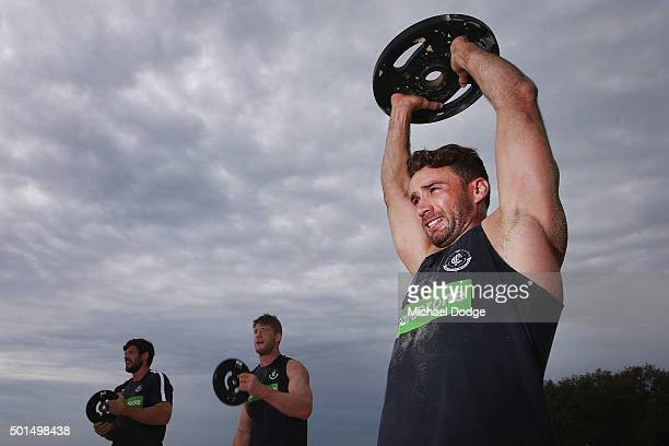 Andrew Walker lifts weights during a circuit training session at Kurrawa Beach during the Carlton Blues AFL preseason training camp on December 16...