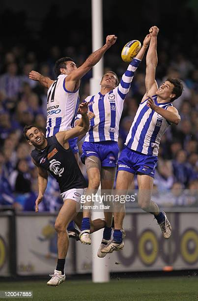 Andrew Walker of the Blues has a marking attempt spoilt by Michael Firrito Cameron Richardson and Scott Thompson of the Kangaroos during the round 19...