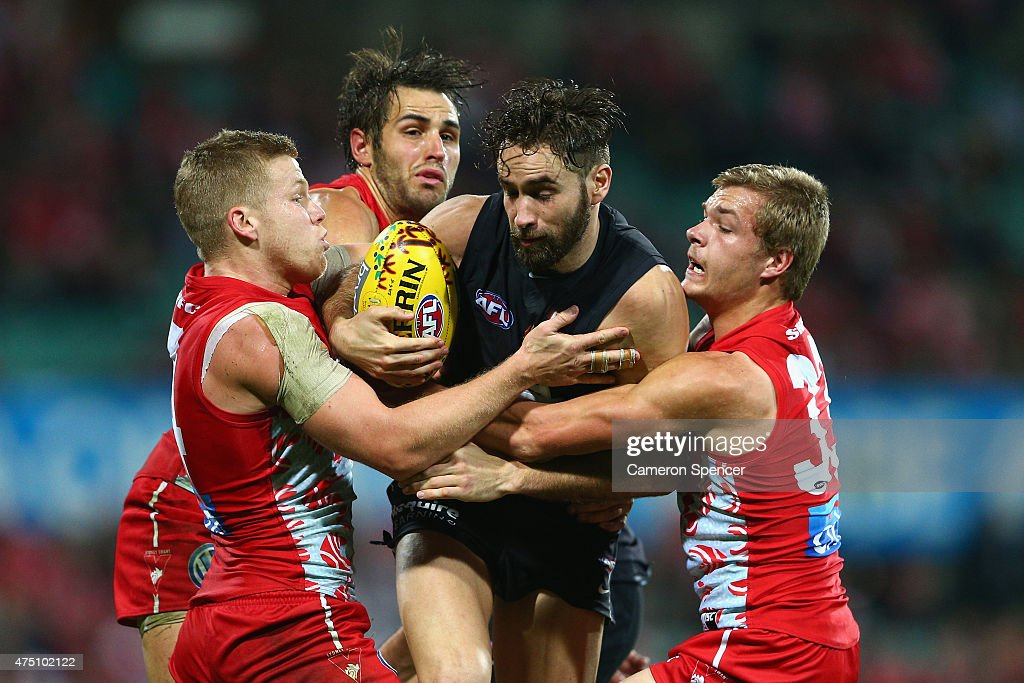Andrew Walker of the Blues is tackled during the round nine AFL match between the Sydney Swans and the Carlton Blues at SCG on May 29, 2015 in Sydney, Australia.