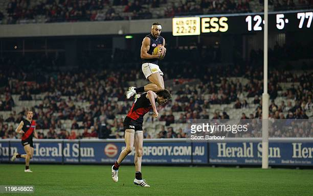 Andrew Walker of the Blues takes a mark over Jake Carlisle of the Bombers during the round 18 AFL match between Essendon Bombers and the Carlton...