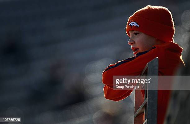 Andrew Wanbaugh age 12 of Casper Wyoming looks on from the stands as the Denver Broncos host the Houston Texas at INVESCO Field at Mile High on...