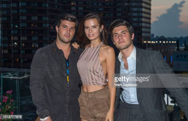 Andrew Warren Alex Assoulline and Michaela Vybohova attend the Gotham Summer Sundown on August 8 2018 in New York City