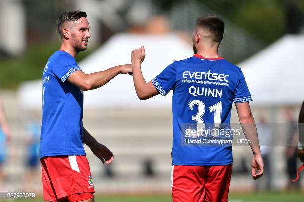 Andrew Waterworth and Niall Quinn of Linfield FC celebrate their team victory following the UEFA Champions League 2020/21 Preliminary Round...