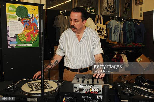 Andrew Weatherall DJing at decks in store at Rough Trade East record shop on April 18 2009 in London England