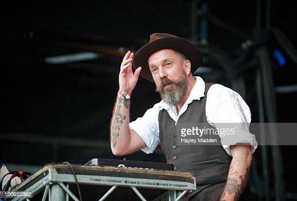 Andrew Weatherall performs DJ set on stage during The Apple Cart Festival 2011 at Victoria Park on August 7 2011 in London United Kingdom