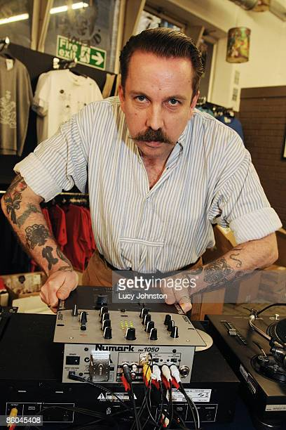 Andrew Weatherall posed behind decks at Rough Trade East record shop on April 18 2009 in London England