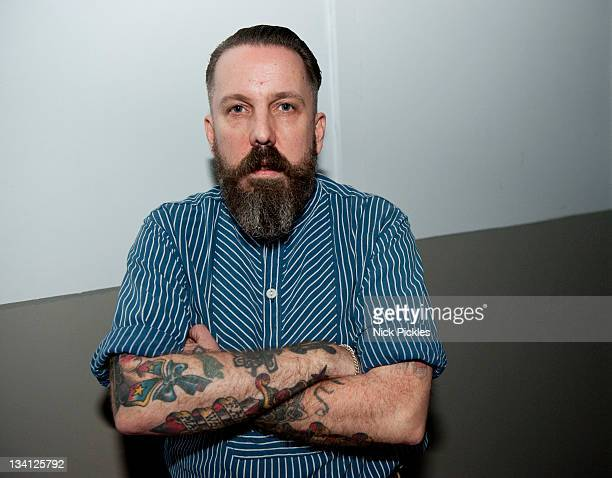 Andrew Weatherall poses backstage at the House of Fun Weekender at Butlins Holiday Centre on November 25 2011 in Minehead England