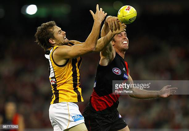 Andrew Welsh of the Bombers spoils Luke Hodge of the Hawks during the round six AFL match between the Essendon Bombers and the Hawthorn Hawks at the...