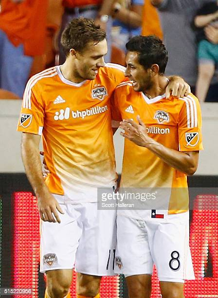 Andrew Wenger and Cristian Maidana of Houston Dynamo celebrate after Wenger scored the fourth goal of the first half against FC Dallas during their...