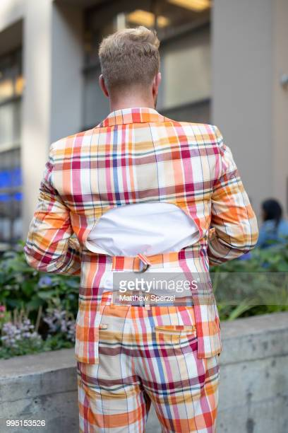 Andrew Werner back detail is seen on the street attending Men's New York Fashion Week wearing a Mr Turk suit with Fleurd Pins on July 9 2018 in New...