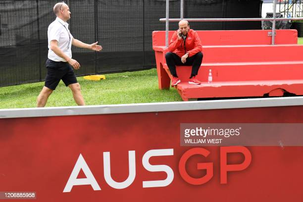 Andrew Westacott , CEO of the Australian Grand Prix Corporation, speaks on the phone after the Formula One Australian Grand Prix was cancelled in...