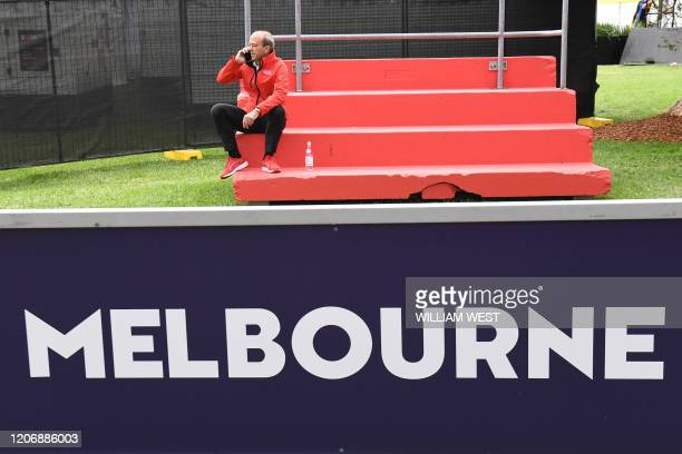 Andrew Westacott, CEO of the Australian Grand Prix Corporation, speaks on the phone after the Formula One Australian Grand Prix was cancelled in...