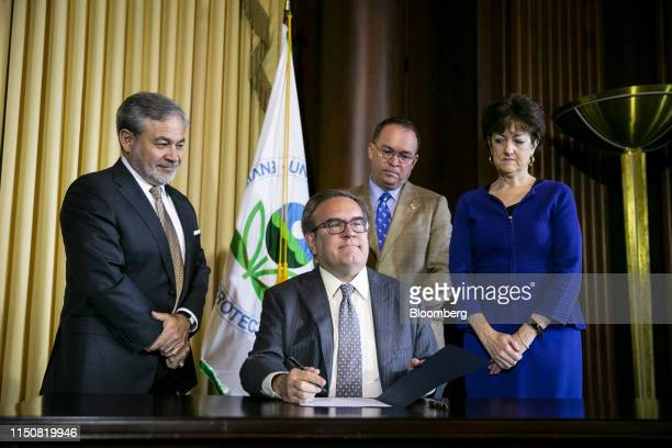 Andrew Wheeler, administrator of the U.S. Environmental Protection Agency , center, prepares to sign the Affordable Clean Energy Rule as Dan...