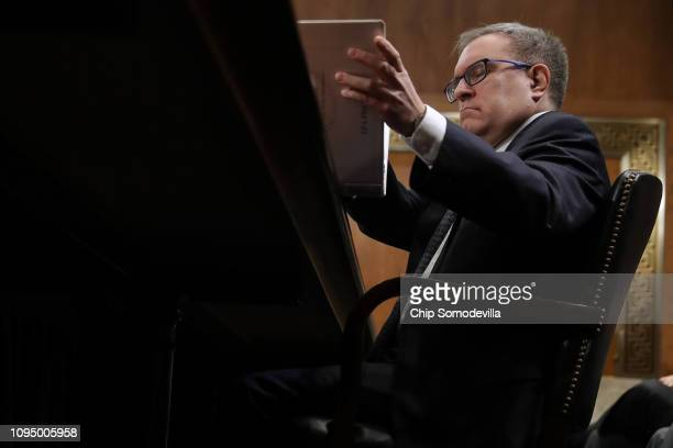 Andrew Wheeler answers senators' questions during his confirmation hearing to be the next administrator of the Environmental Protection Agency before...