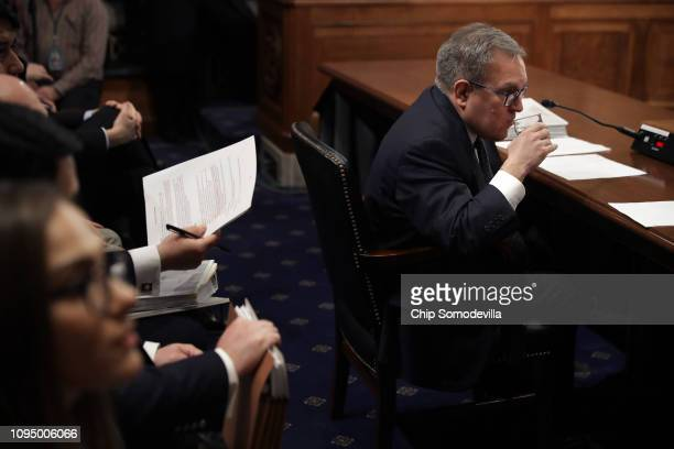 Andrew Wheeler takes a sip of water before the start of his confirmation hearing to be the next administrator of the Environmental Protection Agency...