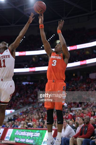 Andrew White III of the Syracuse Orange puts up a shot against Markell Johnson of the North Carolina State Wolfpack at PNC Arena on February 1 2017...
