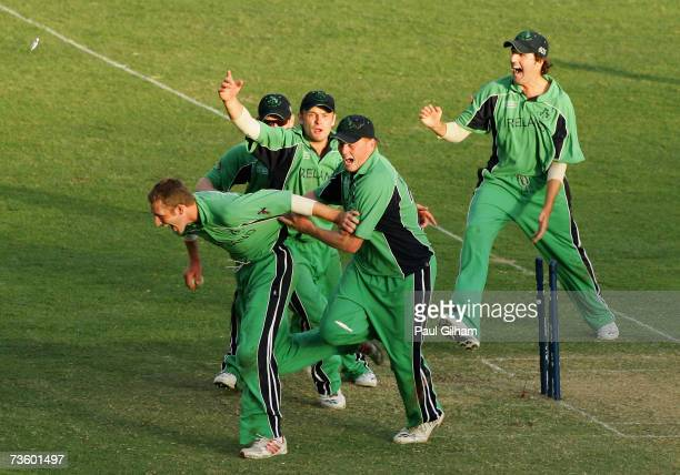 Andrew White Kevin O'Brien and William McCallan lead the celebrations with their teammates as Ireland celebrates drawing with Zimbabwe during the ICC...