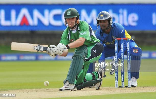 Andrew White of Ireland hits out watched by Kumar Sangakkara of Sri Lanka during the ICC World Twenty20 Super Eights match between Ireland and Sri...