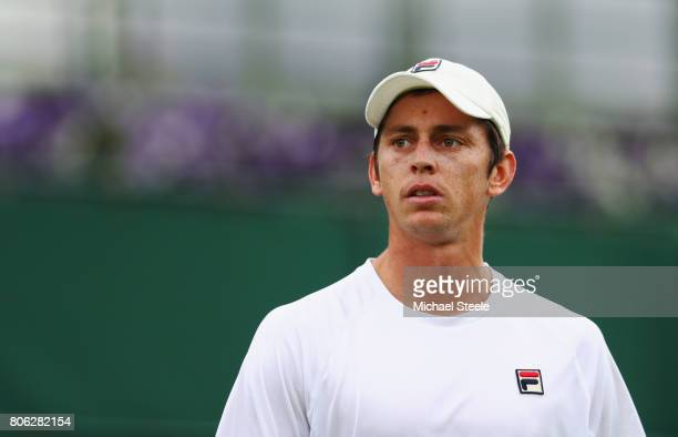 Andrew Whittington of Australia looks on during the Gentlemen's Singles first round match on day one of the Wimbledon Lawn Tennis Championships at...