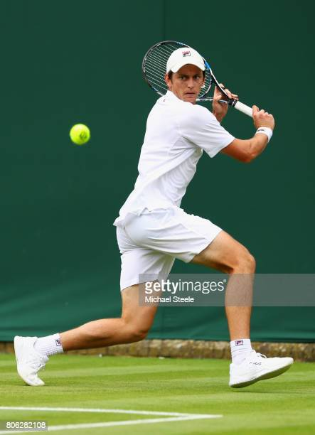 Andrew Whittington of Australia plays a backhand during the Gentlemen's Singles first round match on day one of the Wimbledon Lawn Tennis...