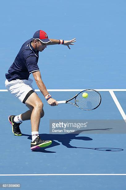 Andrew Whittington of Australia plays a backhand shot in his match against Borna Coric of Croatia during day one of the 2017 Priceline Pharmacy...