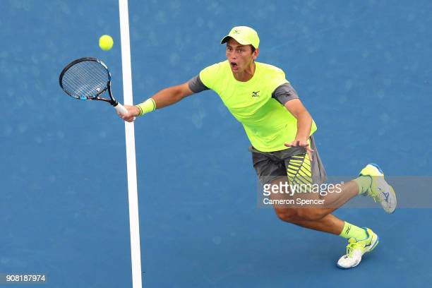 Andrew Whittington of Australia plays a forehand in his third round doubles match with Ellen Perez of Australia against Timea Babos of Hungary and...
