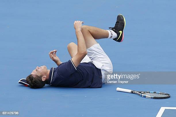 Andrew Whittington of Australia rolls his ankle in his match against Mikhail Youzhny of Russia during day two of the 2017 Priceline Pharmacy Classic...