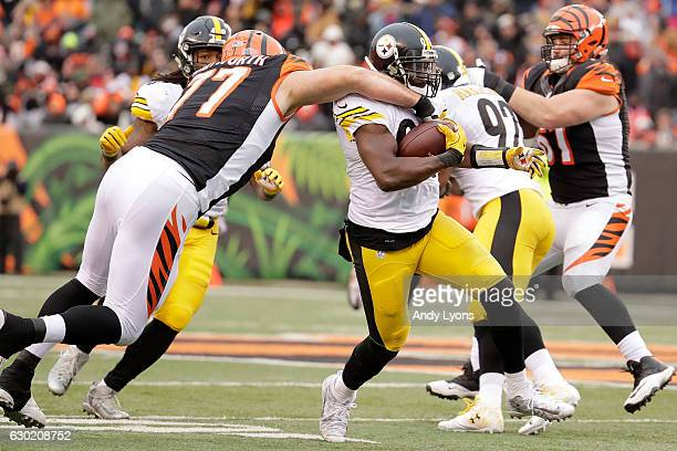 Andrew Whitworth of the Cincinnati Bengals tackles Lawrence Timmons of the Pittsburgh Steelers after making an interception during the third quarter...