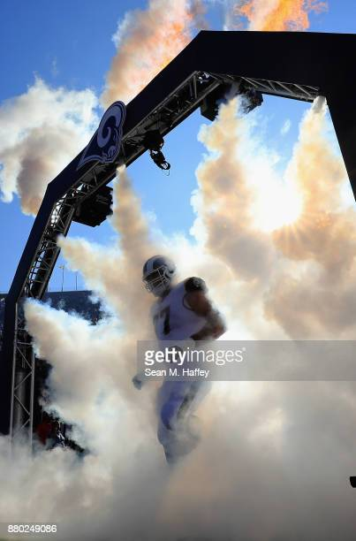 Andrew Whitworth of the Los Angeles Rams enters the field through smoke prior to a game against the New Orleans Saints at Los Angeles Memorial...