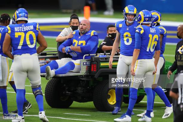 Andrew Whitworth of the Los Angeles Rams is carted off the field in the first quarter against the Seattle Seahawks at SoFi Stadium on November 15,...