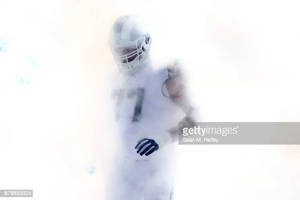 Andrew Whitworth of the Los Angeles Rams runs onto the field prior to the game against the New Orleans Saints at the Los Angeles Memorial Coliseum on...