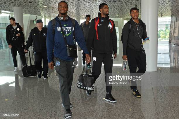 Andrew Wiggins Amile Jefferson and Marcus GeorgesHunt of the Minnesota Timberwolves exit the plane in Shenzhen China for 2017 NBA Global Games China...