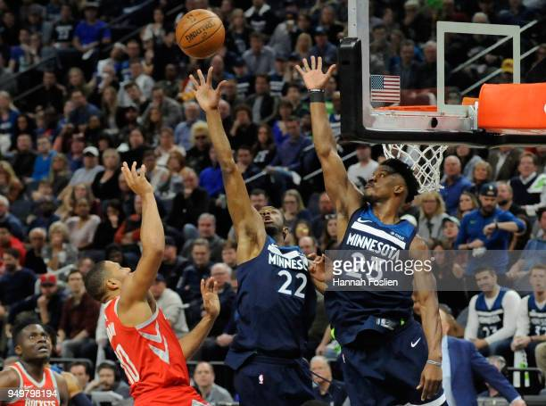 Andrew Wiggins and Jimmy Butler of the Minnesota Timberwolves block a shot by Eric Gordon of the Houston Rockets during the fourth quarter in Game...