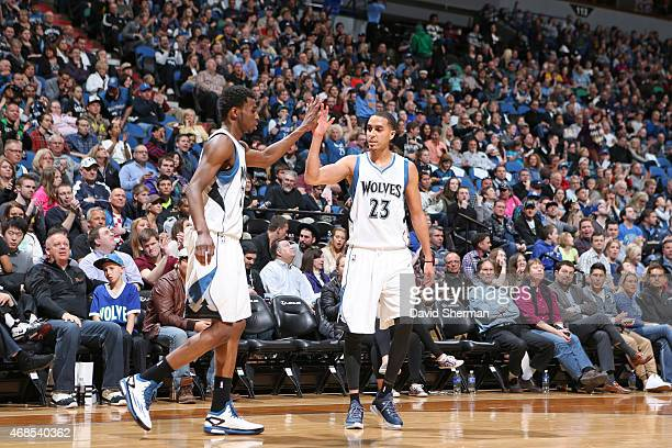 Andrew Wiggins and Kevin Martin of the Minnesota Timberwolves celebrate during the game against the Orlando Magic on April 3 2015 at Target Center in...