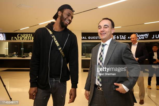 Andrew Wiggins and President of Basketball Operations Gersson Rosas of the Minnesota Timberwolves attend a press conference to introduce Ryan...