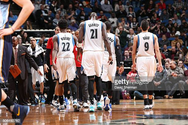 Andrew Wiggins Kevin Garnett and Ricky Rubio of the Minnesota Timberwolves walks off against the Memphis Grizzlies on January 23 2016 at Target...