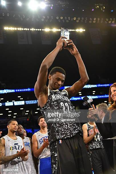 Andrew Wiggins Minnesota Timberwolves hold up his MVP Trophy after the 2015 NBA AllStar Rookie Rising Stars Challenge at Barclays Center on February...
