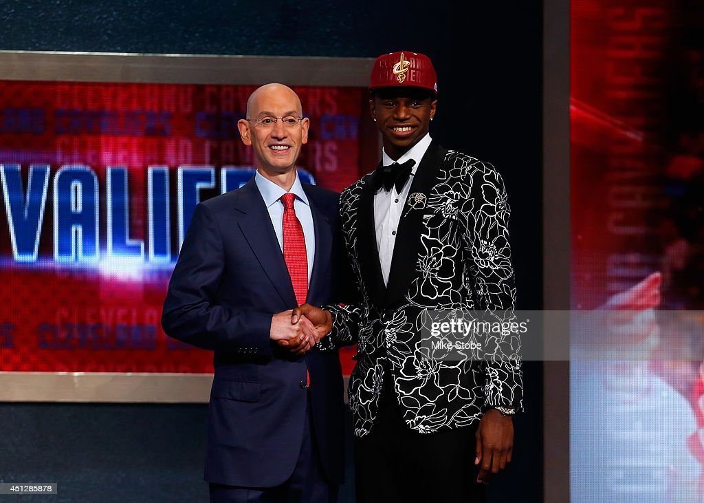 Andrew Wiggins (R) of Kansas poses for a photo with NBA Commissioner Adam Silver after Wiggins was drafted #1 overall in the first round by the Cleveland Cavaliers during the 2014 NBA Draft at Barclays Center on June 26, 2014 in the Brooklyn borough of New York City.