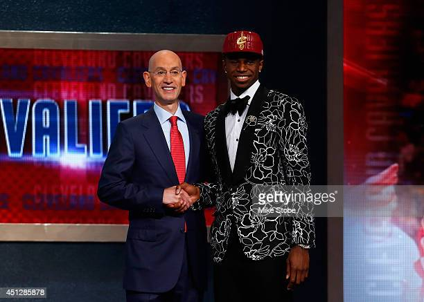 Andrew Wiggins of Kansas poses for a photo with NBA Commissioner Adam Silver after Wiggins was drafted overall in the first round by the Cleveland...