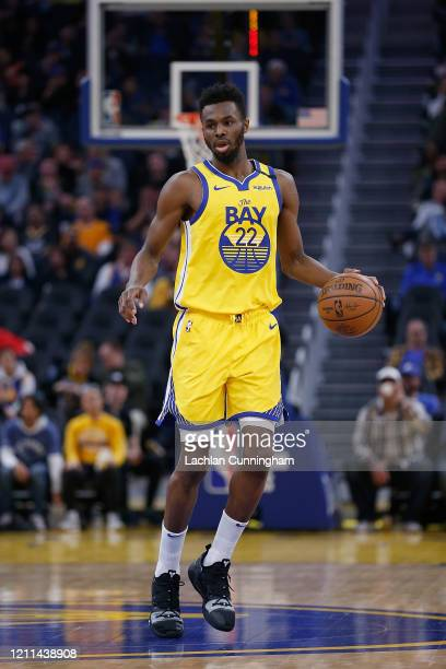 Andrew Wiggins of the Golden State Warriors dribbles the ball up court in the second half against the Philadelphia 76ers at Chase Center on March 07,...