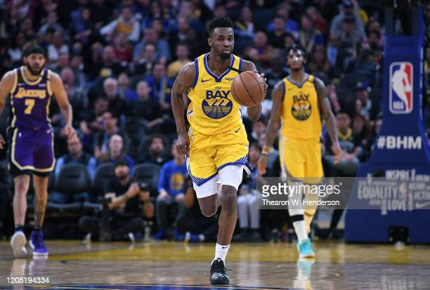 Andrew Wiggins of the Golden State Warriors dribbles the ball up court against the Los Angeles Lakers during the second half of an NBA basketball...