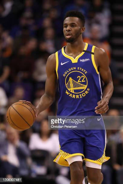 Andrew Wiggins of the Golden State Warriors handles the ball during the NBA game against the Phoenix Suns at Talking Stick Resort Arena on February...