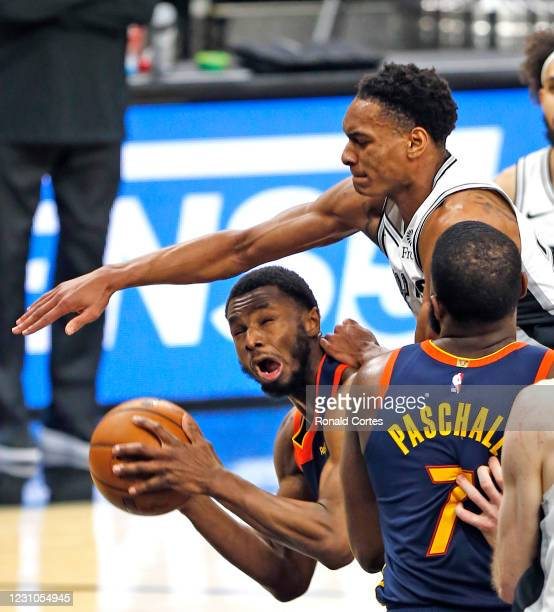 Andrew Wiggins of the Golden State Warriors is fouled by Devin Vassell of the San Antonio Spurs during the second half at AT&T Center on February 8,...