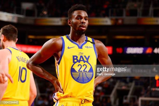Andrew Wiggins of the Golden State Warriors look on during the game against the Phoenix Suns on February 29, 2020 at Talking Stick Resort Arena in...