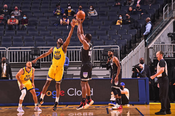 Andrew Wiggins of the Golden State Warriors plays defense against the Sacramento Kings on April 25, 2021 at Chase Center in San Francisco,...