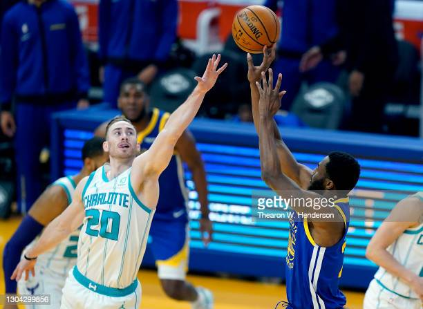Andrew Wiggins of the Golden State Warriors shoots over Gordon Hayward of the Charlotte Hornets during the first half of an NBA basketball game at...