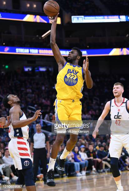 Andrew Wiggins of the Golden State Warriors shoots over Ish Smith of the Washington Wizards during the second half of an NBA basketball game at Chase...