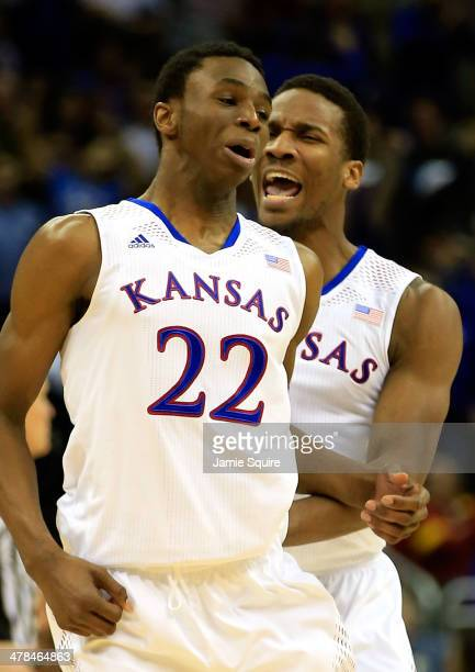 Andrew Wiggins of the Kansas Jayhawks is congratulated by Wayne Selden Jr #1 after dunking on an alleyoop during the Big 12 Basketball Tournament...