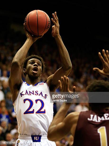 Andrew Wiggins of the Kansas Jayhawks shoots over Jayon James of the Louisiana Monroe Warhawks during the game at Allen Fieldhouse on November 8 2013...