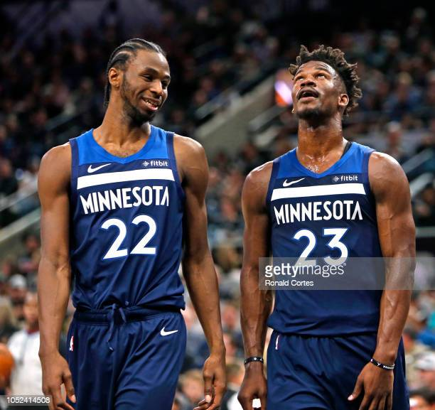 Andrew Wiggins of the Minnesota Timberwolves and Jimmy Buttler talk after a foul called against the San Antonio Spurs in season opener at ATT Center...